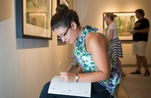 Randolph College student in gallery studying