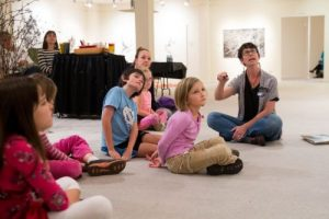 children learning about art in gallery